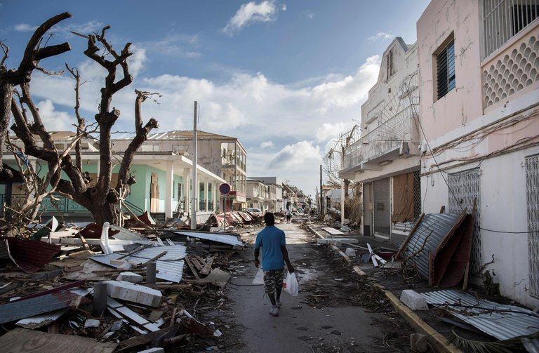 A street in St. Martin after Hurricane Irma. Residents spoke of a disintegration in law and order as survivors struggled in the face of severe food and water shortages. Credit Martin Bureau/Agence France-Presse — Getty Images